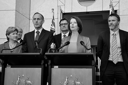 Former Prime Minister Julia Gillard giving a speech at a lectern