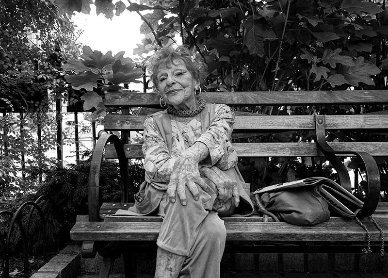 Elderly Lady Sitting on a Park Bench
